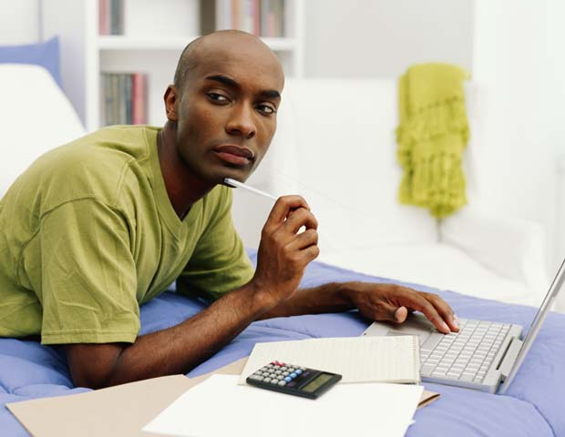 Black Man on Computer